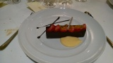 An extremely attractively laid out dessert. It was a pudding in a dark chocolate trough with strawberries